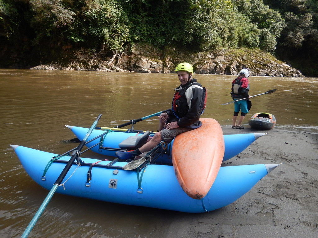 Giving a kayaker a ride on the Rio Quijos